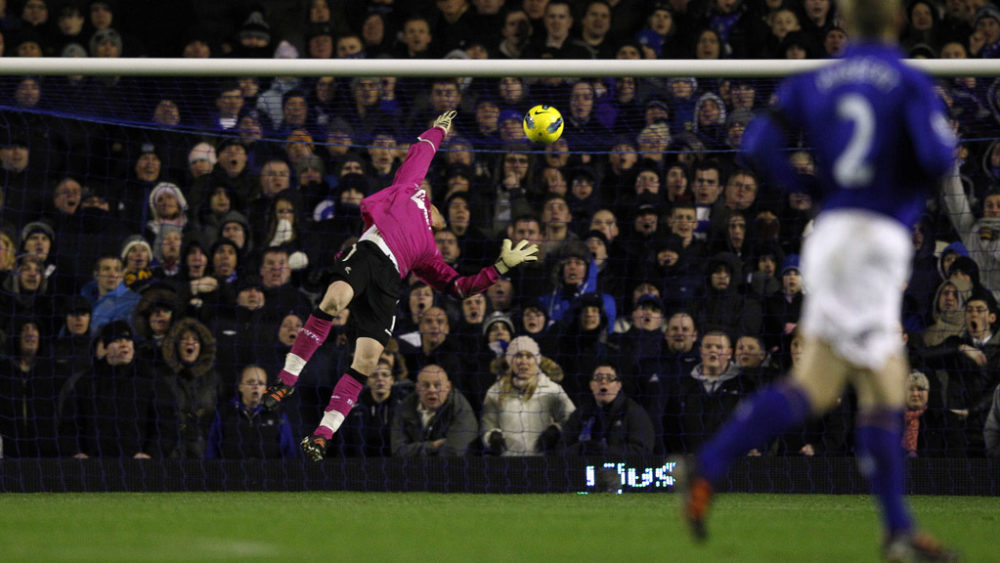 Everton's goalkeeper Tim Howard scores a spectacular goal - aided by the windy conditions - against Bolton Wanderers during their fixture in Liverpool.