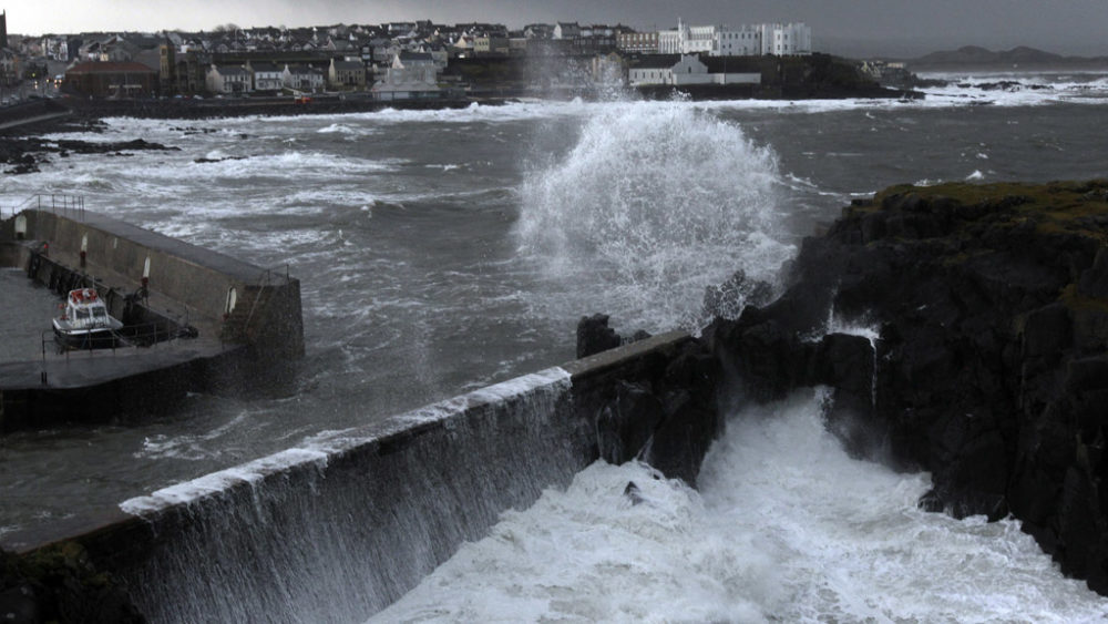 Waves crash against the harbour wall at Portstewart in northern Ireland. Some 60 locals braved the waters for a charity swim last week, but choppy waters mean it is too dangerous to do so today.
