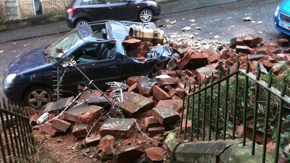 Filibrilu in Glasgow woke up to a smashed car and chimney stack, but saw the lighter side.