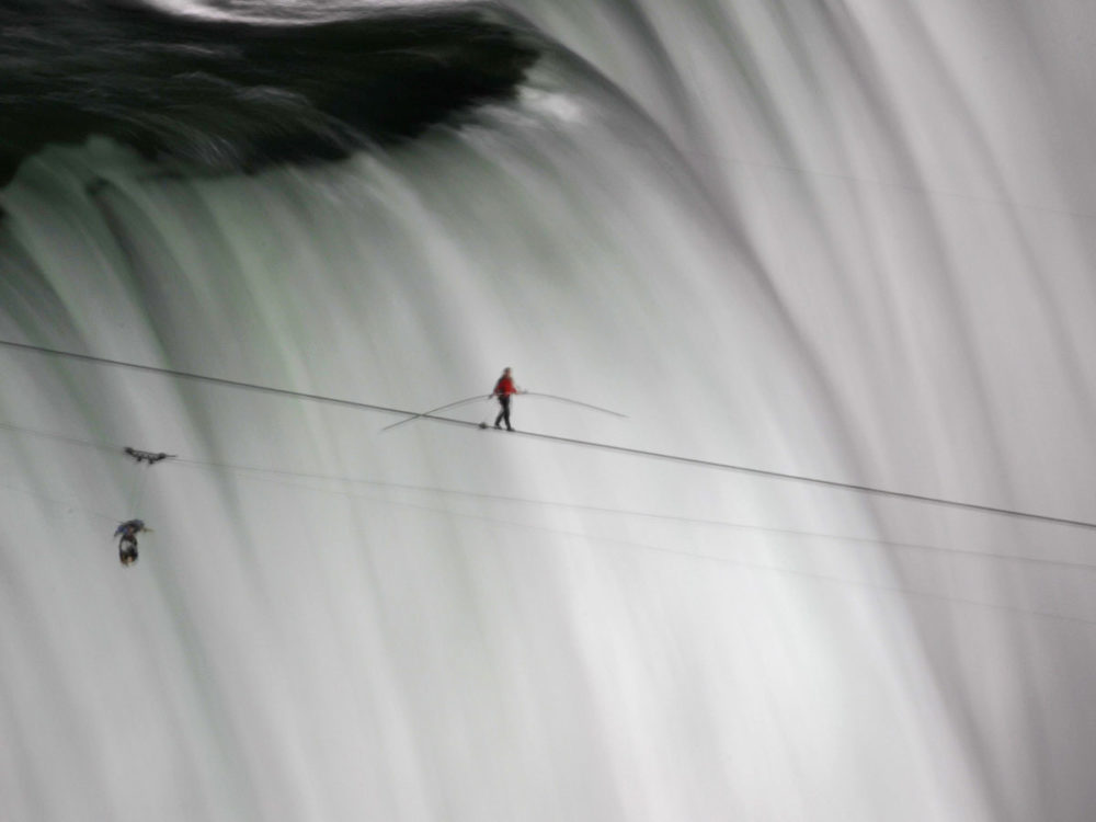 Aerialist Nik Wallenda made a historic tightrope crossing over Niagara Falls on a 2-inch wide cable. (Reuters)