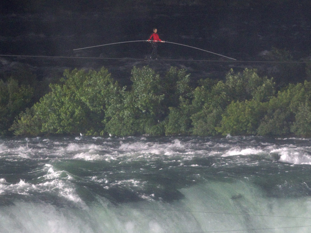 Wallenda took 25 minutes to cross the 550m gap from the US side to Canada over the dangerous waters. (Reuters)