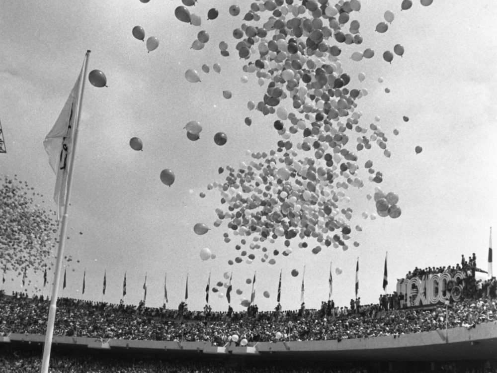 Balloons were released over Mexico City's Olympic Stadium for the start of the 1968 Olympic Games, in the year that Tommie Smith and John Carlos raised their black-gloved fists in a human rights protest.