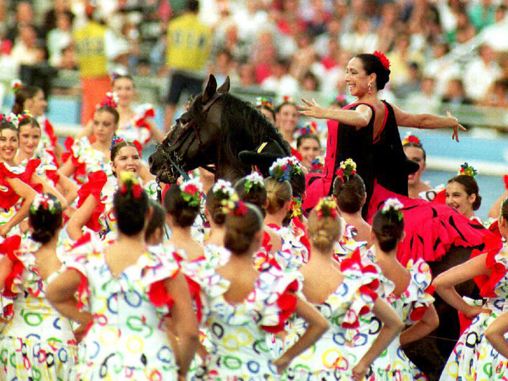Flamenco dancer Cristina Hoyos rode a horse through a crowd of dancers at the Olympic Games opening ceremony in Barcelona in 1992. The Olympic torch was lit in a stunt featuring Paralympic archer Antonio Rebollo.