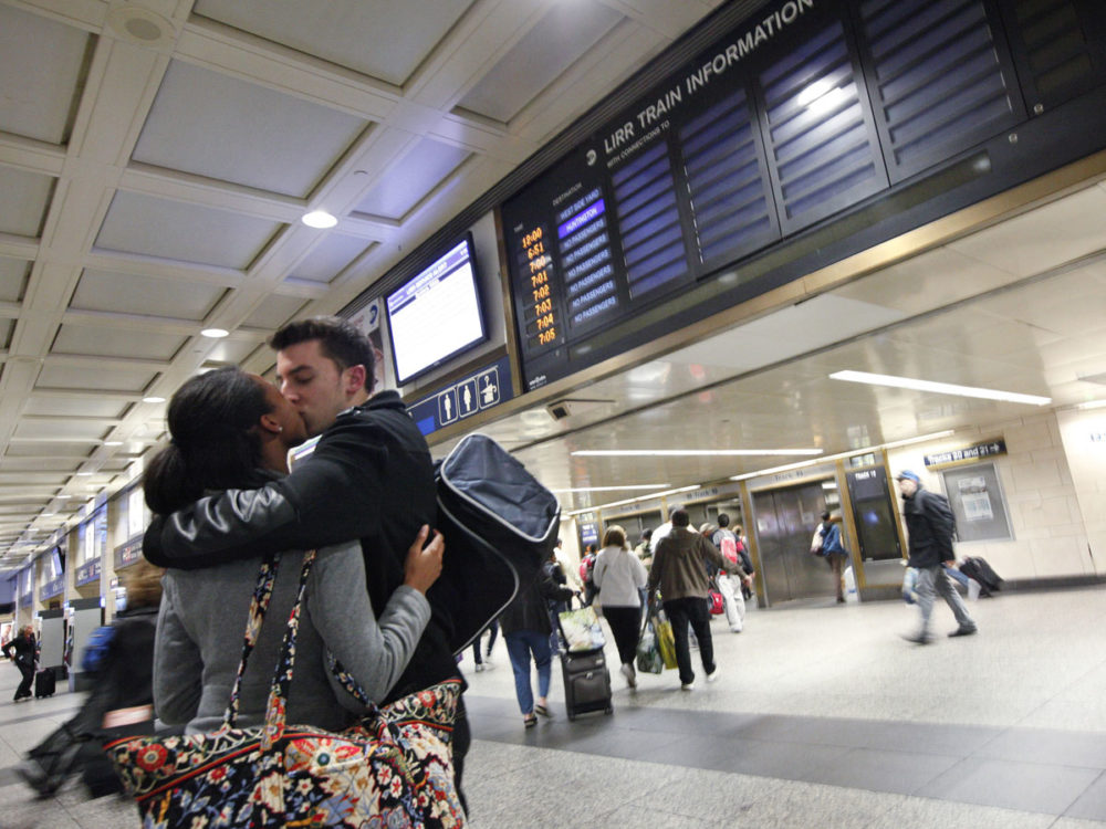 A couple kiss goodbye before the last train to Long Island departs Penn Station in New York, 28 October, 2012. (Reuters)