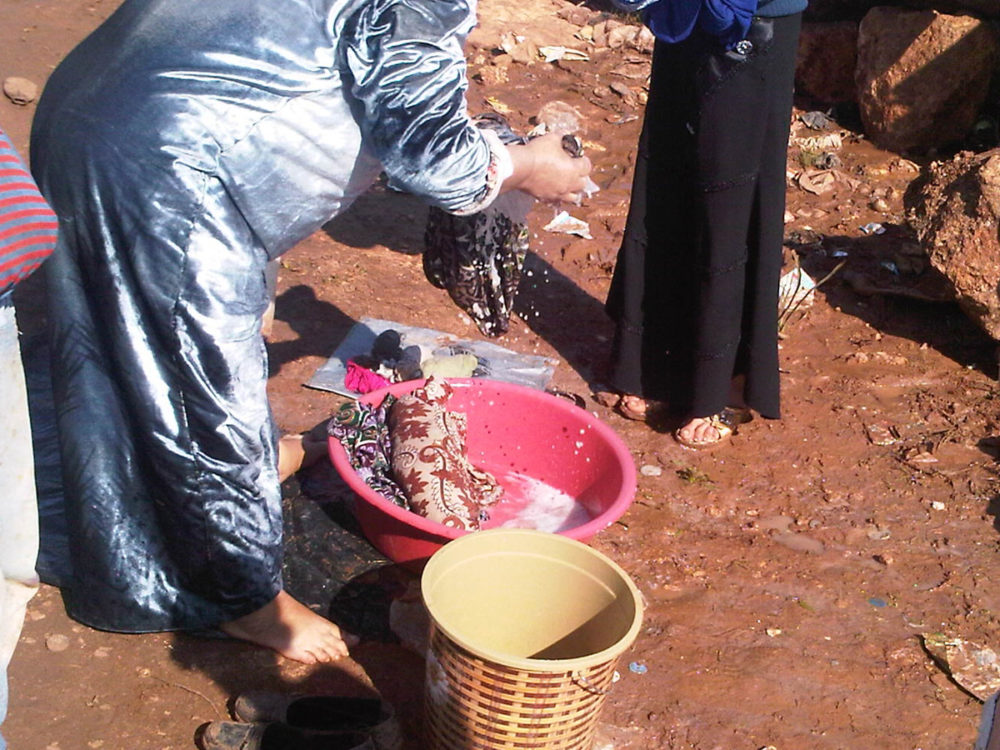Doing washing in Atmeh, Syria. Assad has sent us back to the middle ages, they say.