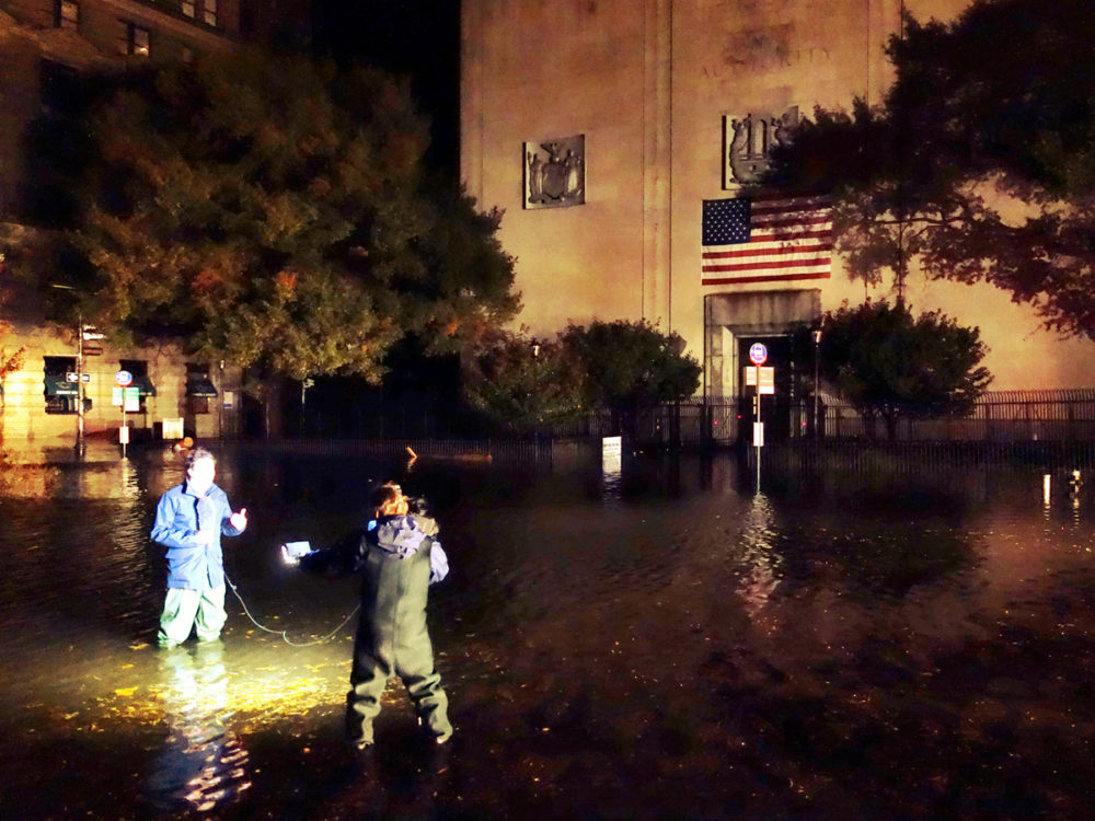 Reporters standing around in puddles. All rights reserved Dai Baker.