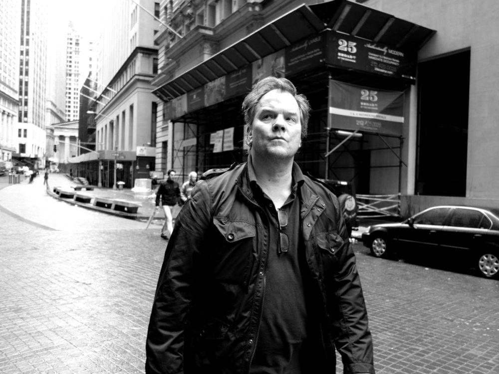 Matt Frei walking through a deserted Wall Street. All rights reserved Dai Baker.