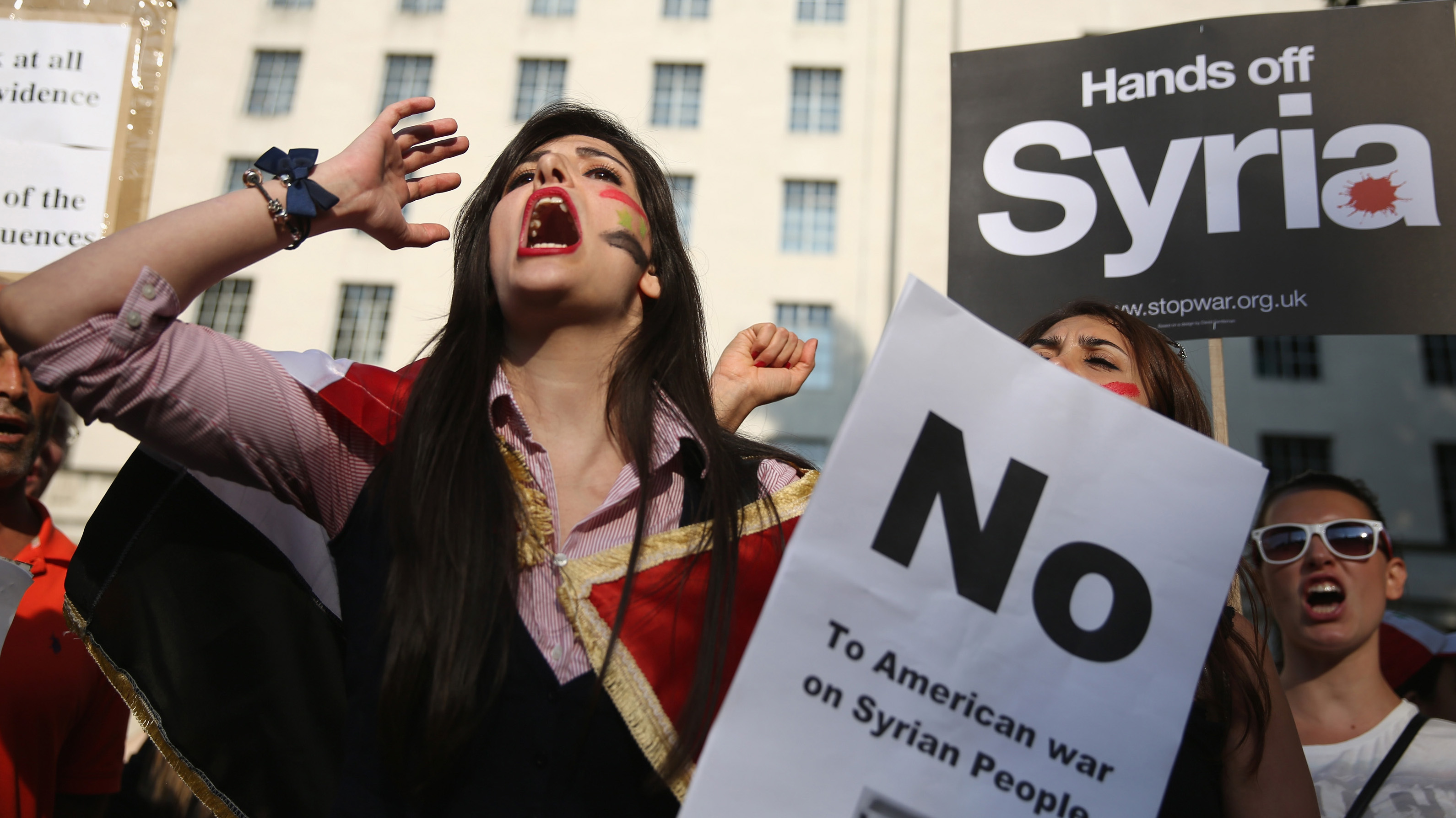 Protesters gather on Whitehall outside Downing Street to campaign for no international military intervention in the ongoing conflict in Syria on August 28,
