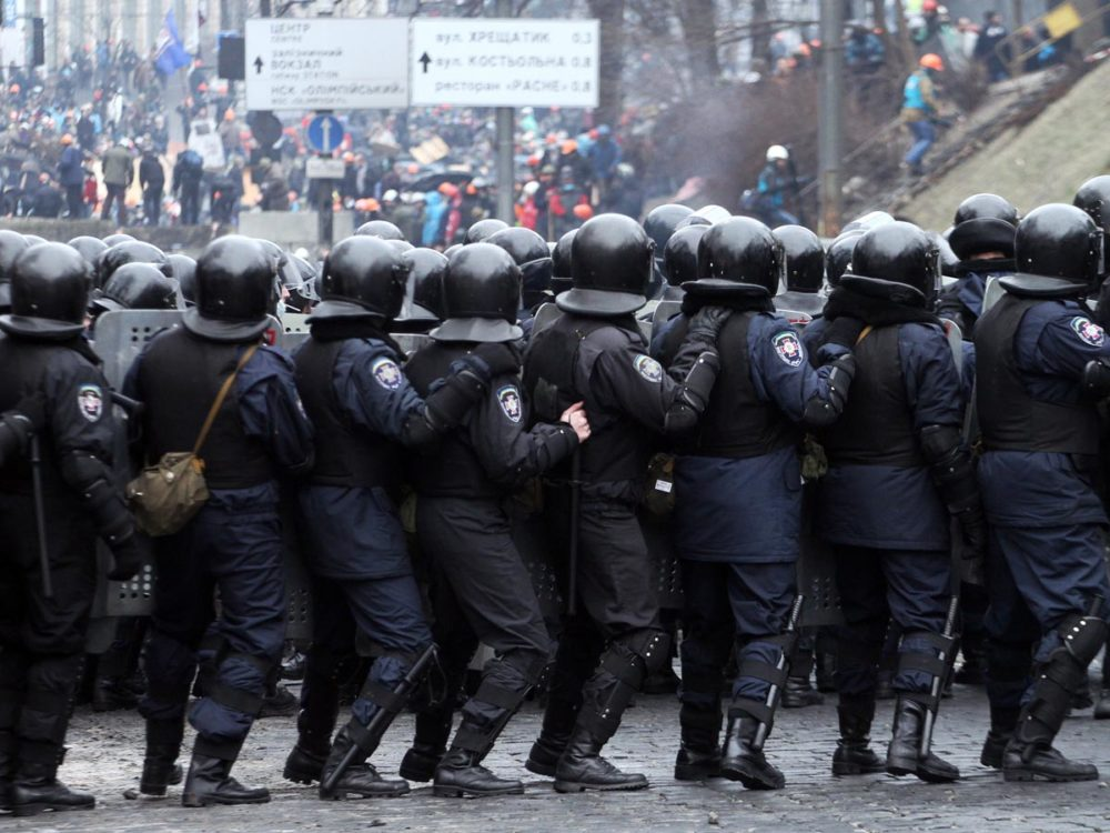 Riot police in Kiev - some have even been captured by protesters as the battles turn into full-scale warfare.