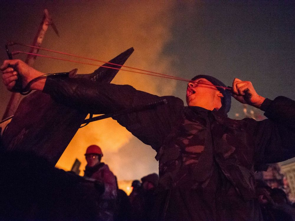 Molotov cocktails, slingshots, and real bullets - the violence on the square has spiralled out of control as Ukraine's president refuses to back down despite international condemnation.