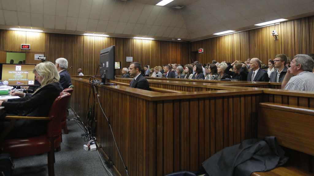 Olympic and Paralympic track star Oscar Pistorius sits in the dock at the North Gauteng High Court in Pretoria