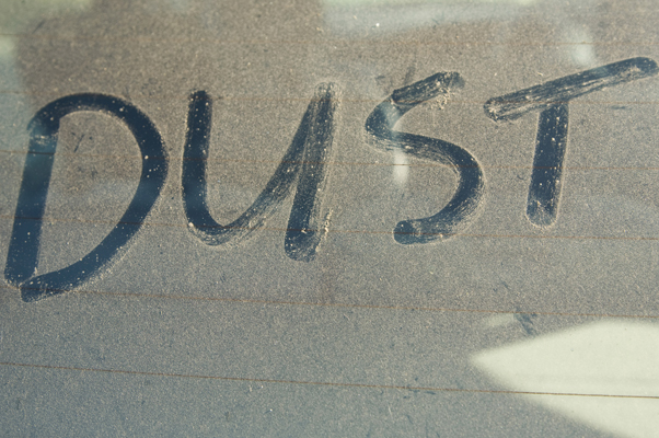 The word 'DUST' written on car rear windscreen following Saharan sand deposited in England by strong south easterly winds