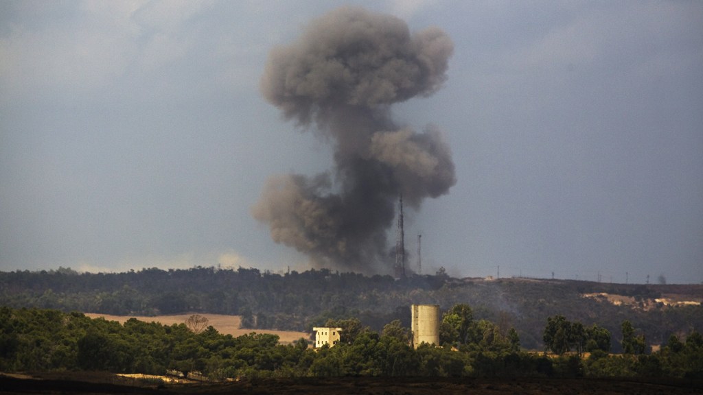 Smoke rises from the Gaza Strip after an Israeli air strike