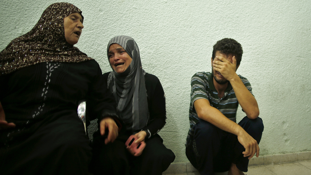 Relatives of Palestinians mourn outside a hospital morgue in the northern Gaza Strip