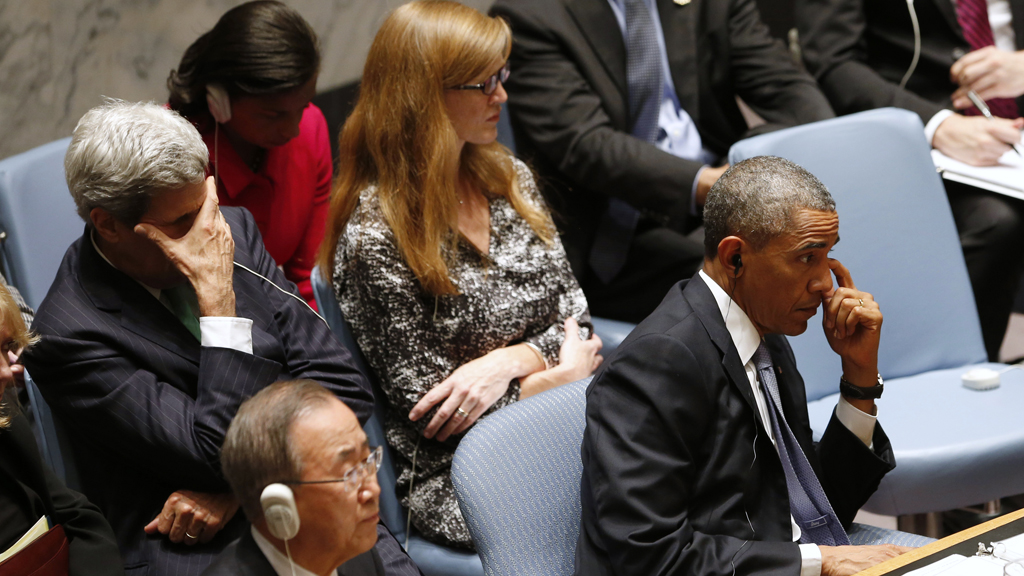 U.S. President Obama and U.S Secretary of State Kerry rub their eyes as Obama chairs the UN Security Council summit in New York