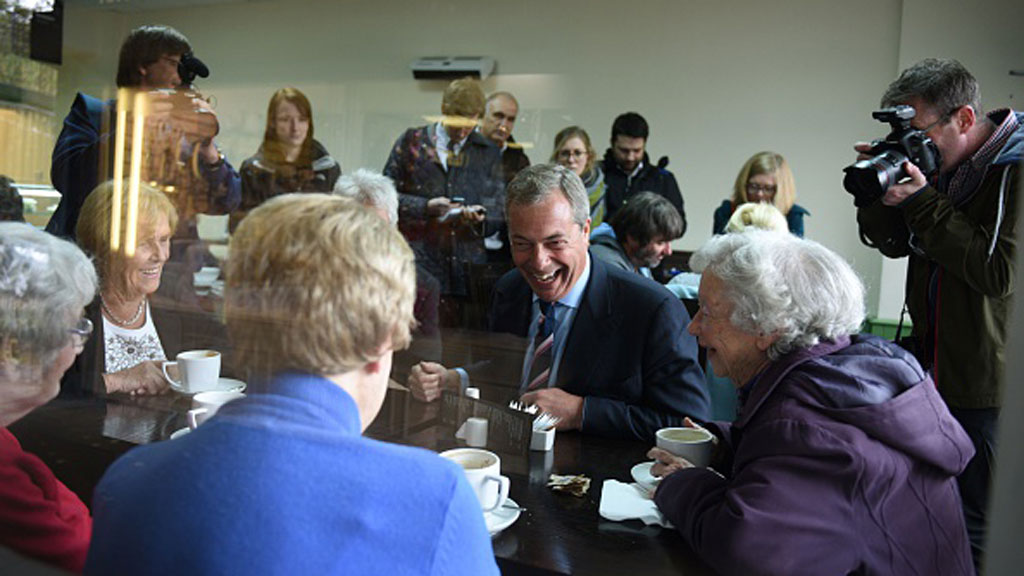 Nigel Farage in a cafe with women