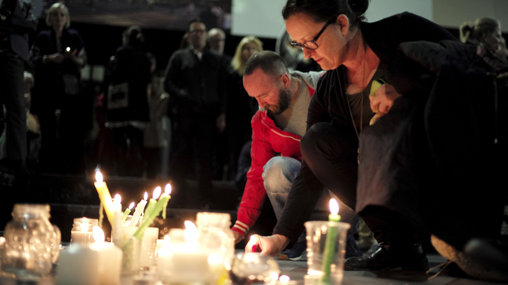 Supporters of Australian convicted drug traffickers Andrew Chan and Myuran Sukumaran light candles during a vigil in Sydney