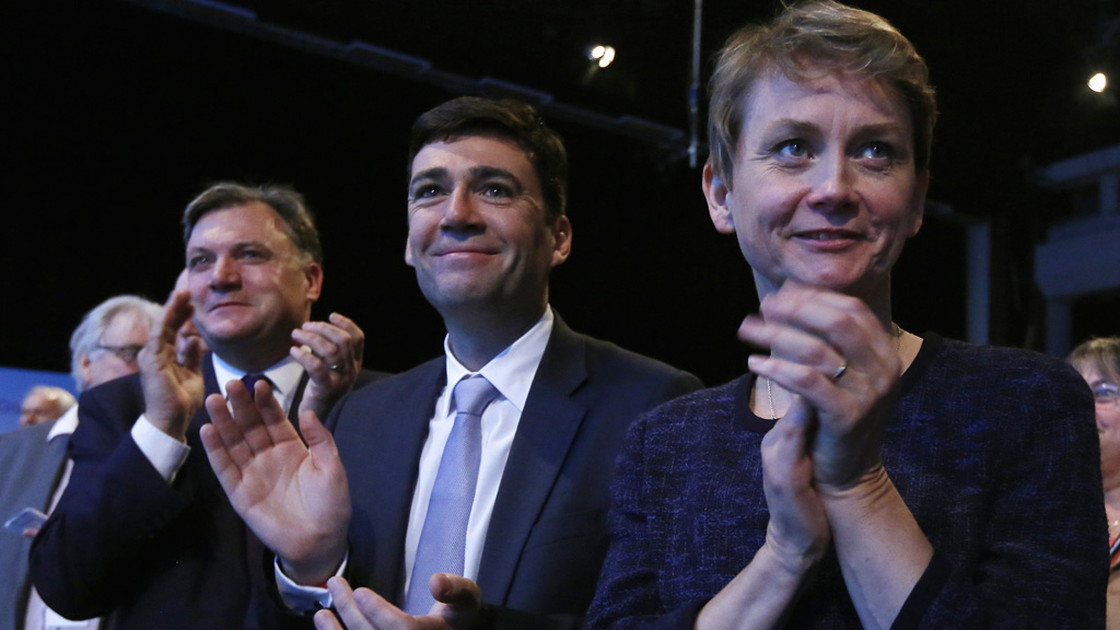 Britain's shadow Chancellor Balls, shadow Health Secretary Burnham and shadow Home Secretary Cooper clap and sing during a rendition of the 'Red Flag' at the close of the Labour party's annual conference in Brighton