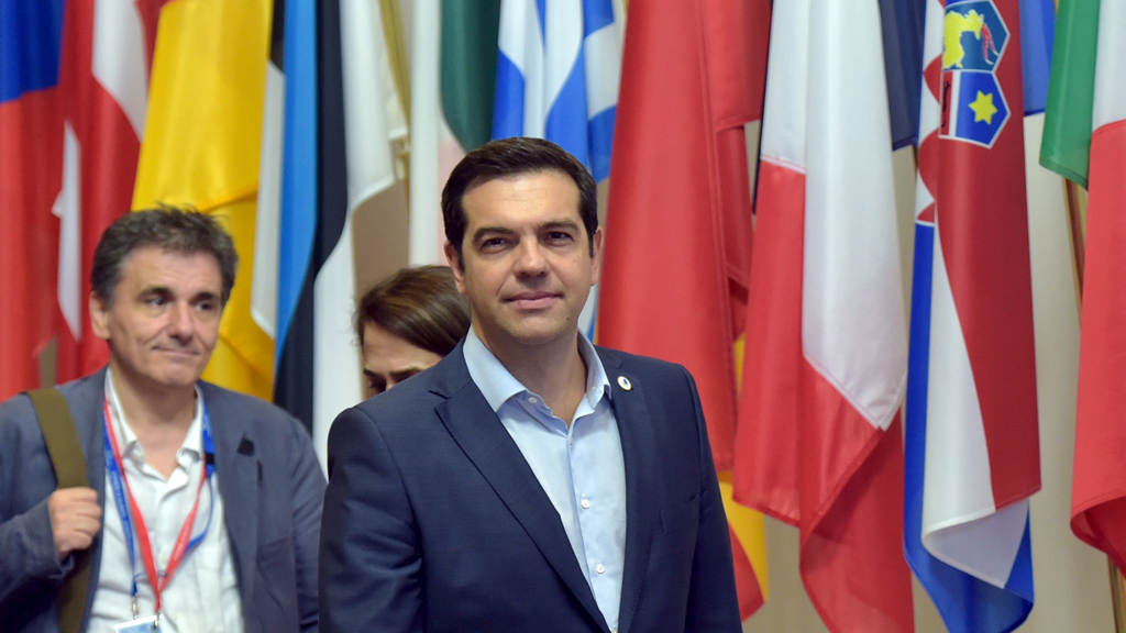 Greece's PM Tsipras and Greek Finance Minister Tsakalotos leave a euro zone leaders summit in Brussels, Belgium