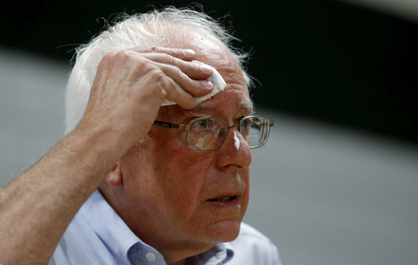 U.S. Democratic presidential candidate and U.S. Senator Bernie Sanders wipes his brow while speaking at a campaign stop in Conway