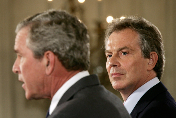 British Prime Minister Tony Blair (R) looks at U.S. President George W. Bush at a joint news conference in the East Room of the White House in Washington June 7, 2005. REUTERS/Jason Reed/File Photo - RTX2JXQ4