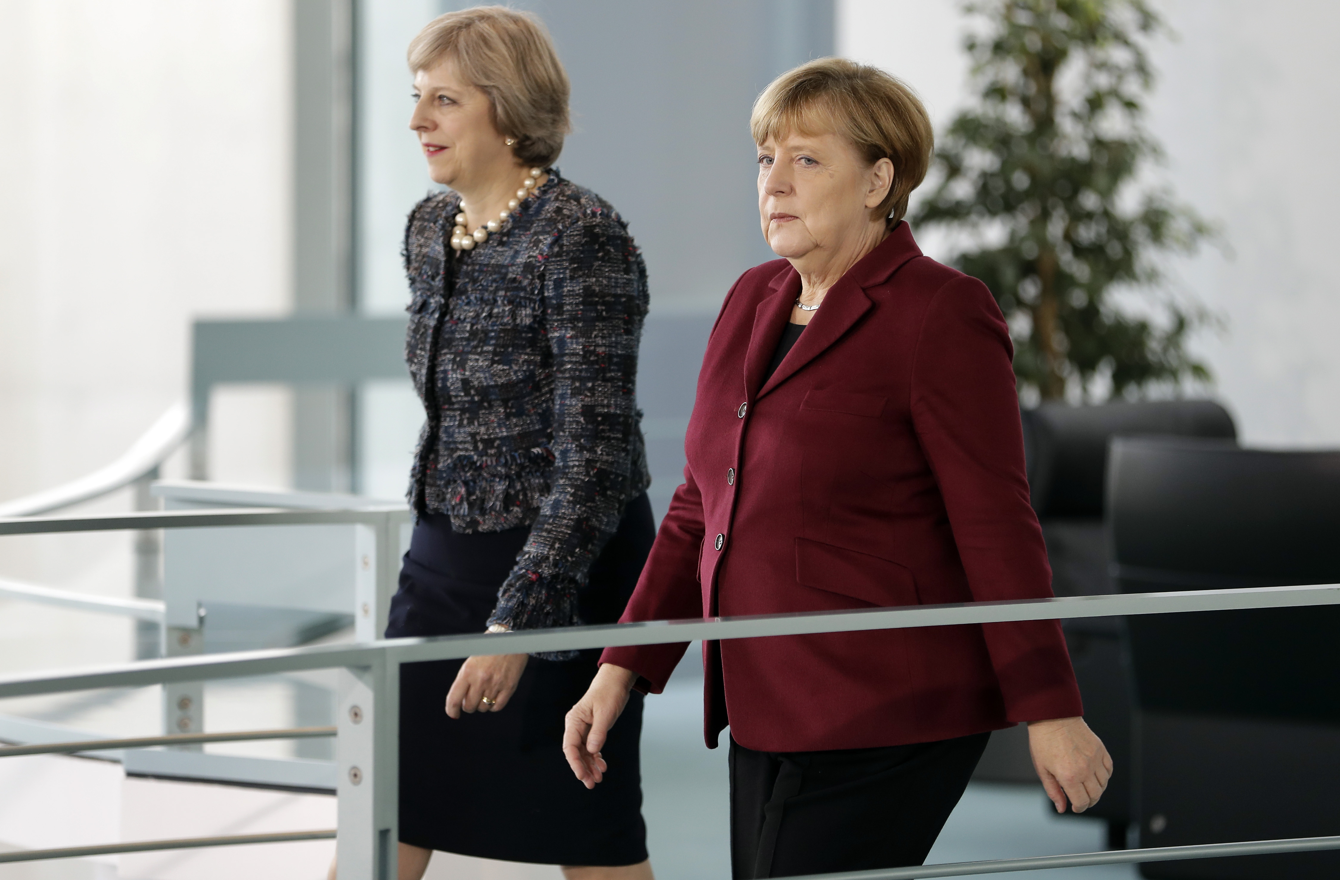 German Chancellor Angela Merkel (R) and Britain's Prime Minister Theresa May arrive for a statement prior to a meeting at the Chancellery in Berlin, Germany, on November 18, 2016. / AFP / POOL / Michael Sohn (Photo credit should read MICHAEL SOHN/AFP/Getty Images)