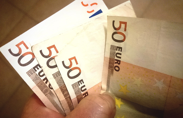 Cropped Hand Holding Fifty Euro Banknotes