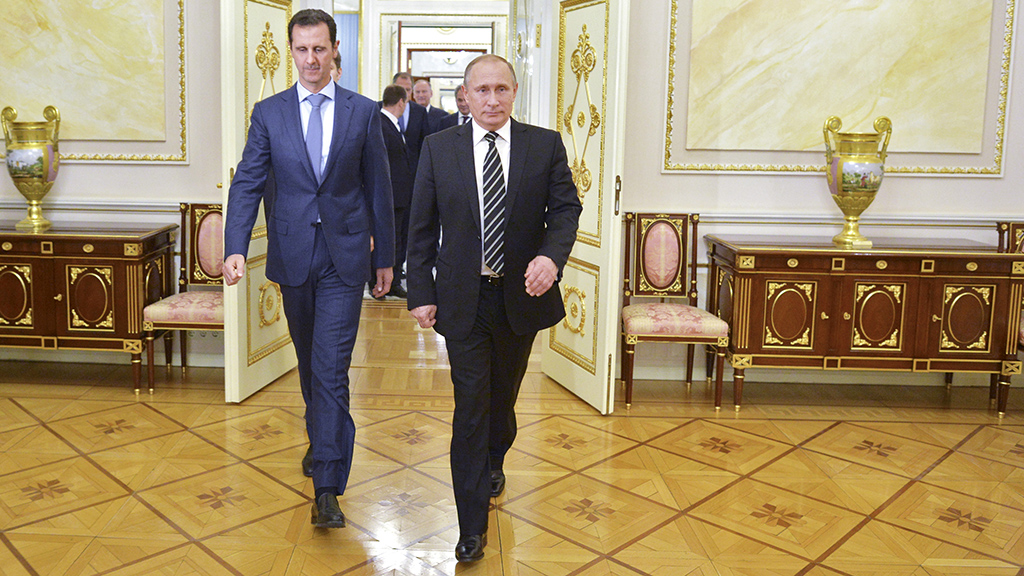 Russian President Vladimir Putin and Syrian President Bashar al-Assad enter a hall during a meeting at the Kremlin in Moscow, Russia, October 20, 2015.