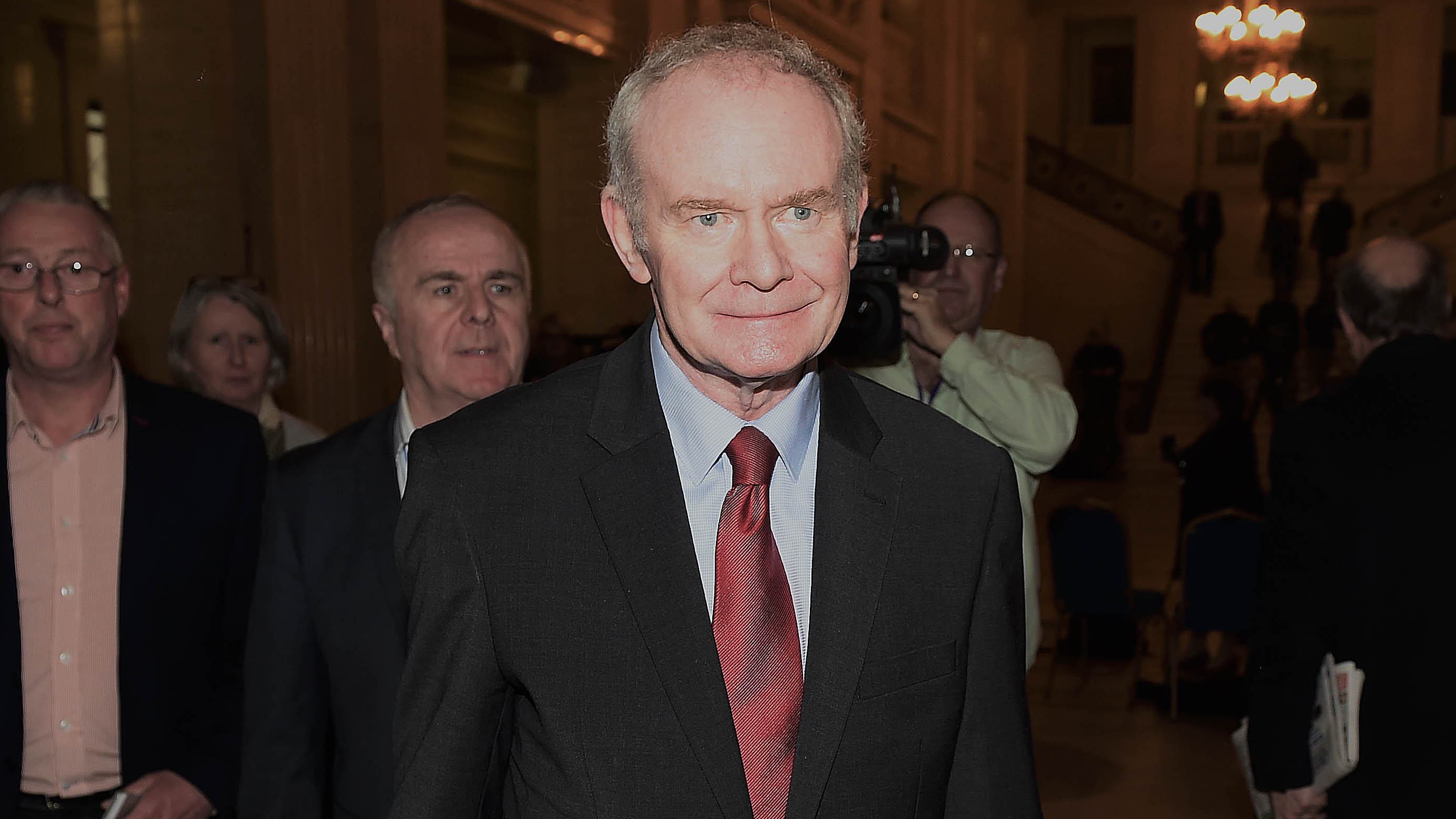 BELFAST, NORTHERN IRELAND - JANUARY 16: Former Deputy Northern Ireland First Minister Martin McGuinness walks through the Great Hall at Stormont after failing to nominate a candidate for the role of Deputy First Minister on January 16, 2017 in Belfast, Northern Ireland. Northern Ireland politics have been plunged into crisis following the RHI Cash for Ash controversy, a renewable heat scheme introduced by the then DETI minister Arlene Foster which could see the Northern Ireland taxpayer facing a bill of over £400 million pounds due to a flaw in the scheme. The resignation of Deputy First Minister Martin McGuinness last week and a failure to re-nominate a Sinn Fein candidate for the position by 5pm today will trigger a snap election. (Photo by Charles McQuillan/Getty Images)