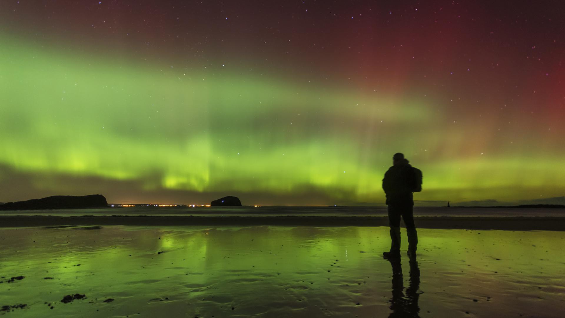 Northern lights over Scottish beach