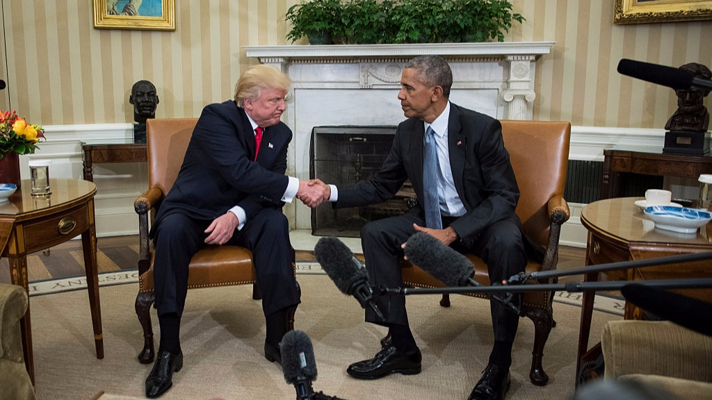 Donald Trump and President Obama shake hands