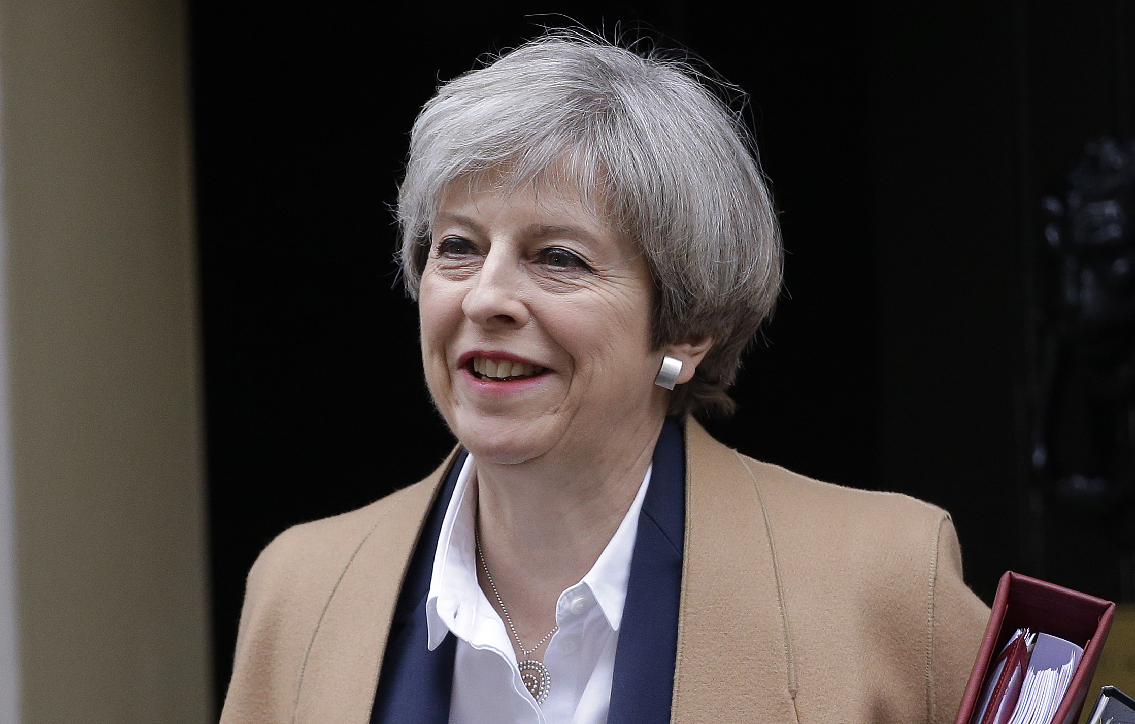 Britain's Prime Minister Theresa May leaves 10 Downing Street on her way to parliament, London, Wednesday March 29, 2017. May will speak to parliament to announce that Britain is set to formally file for divorce from the European Union Wednesday, ending a 44-year relationship, enacting the decision made by U.K. voters in a referendum nine months ago and launching both Britain and the bloc into uncharted territory. (AP Photo/ Alastair Grant)